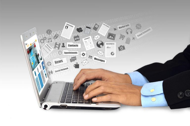 An image of a man's hands as he is browsing the web