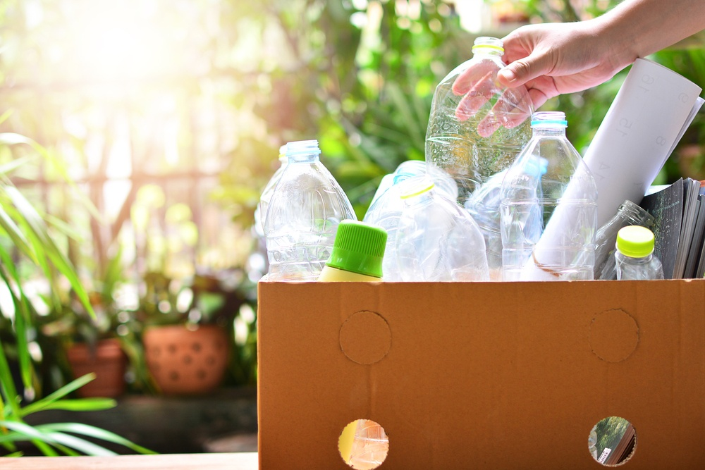 Putting recyclable plastics in a box