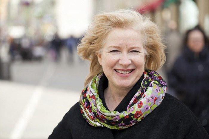 Older woman smiling as an example of jobs for women over 50