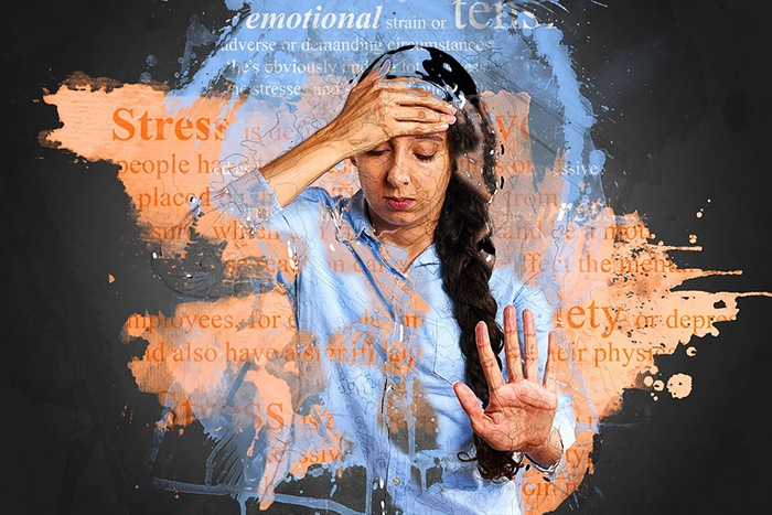 Woman looking stressed out with her hand on her forehead as an example of jobs for people with anxiety