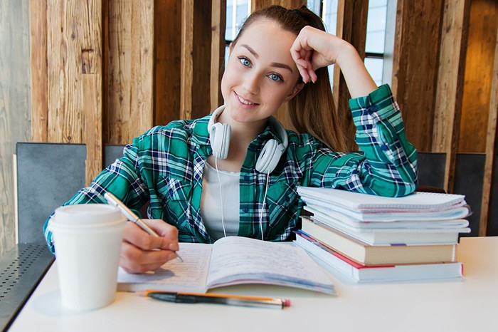 Young girl studying at her desk as an example of job opportunities for college students