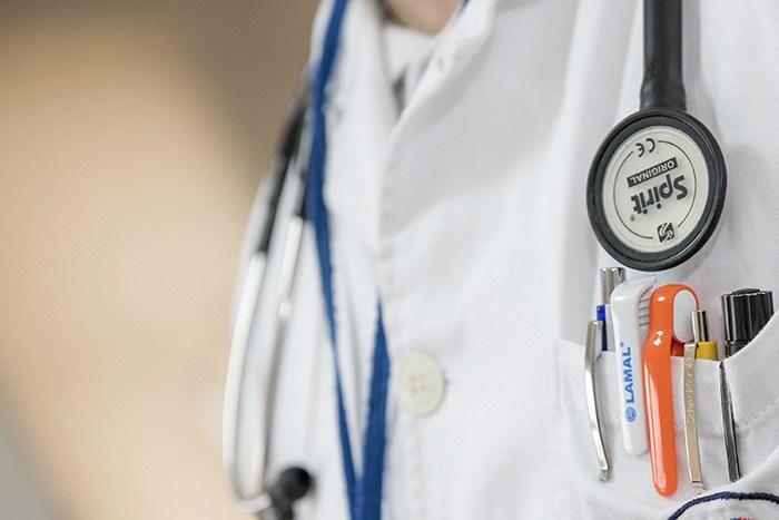 Closeup of a man wearing a nursing uniform as an example of jobs for male nurses