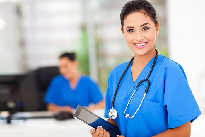 Woman wearing a nursing uniform working as a nurse in a clinical setting representing nurses who want to make a difference