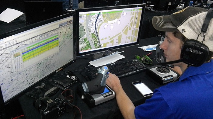Man sitting at computer terminal working as an air traffic controller as an example of ISTP personalities
