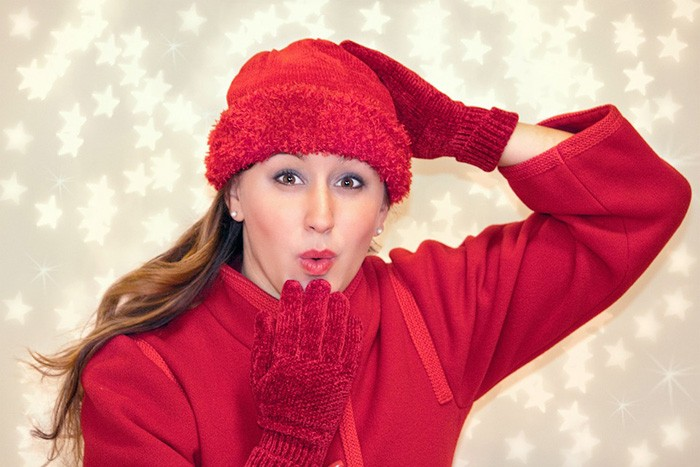 Woman dressed in red Christmas attire representing the best jobs for Christmas