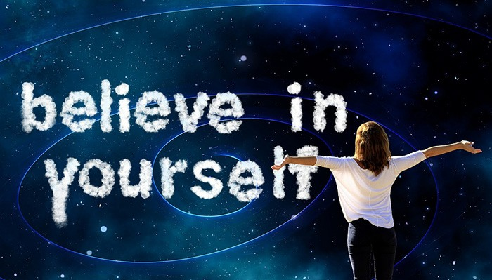 Motivational woman with outstretched arms representing a life coach