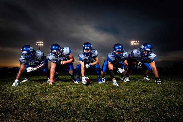 Photo of a football team as an example of getting paid to write about football