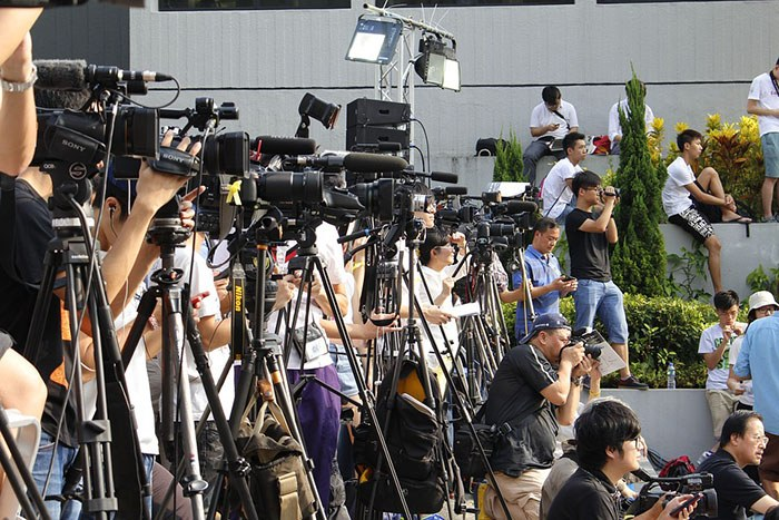 Photo of journalists setting up for a press conference as an example of the best jobs for journalists