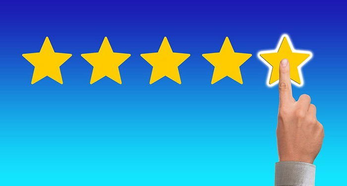 Graphic of a person giving 5-star feedback review as an example of book reviews