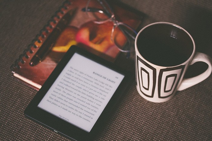 Photo of an e-reader sitting on a table as an example of jobs writing eBooks