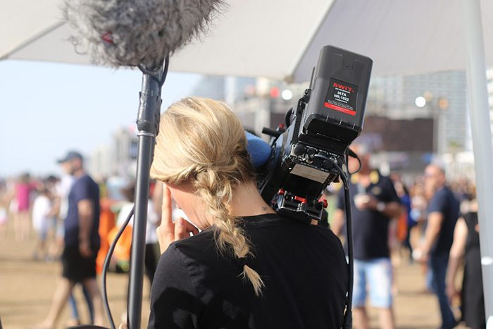 Photo of the set of a television shoot as an example of jobs writing for TV