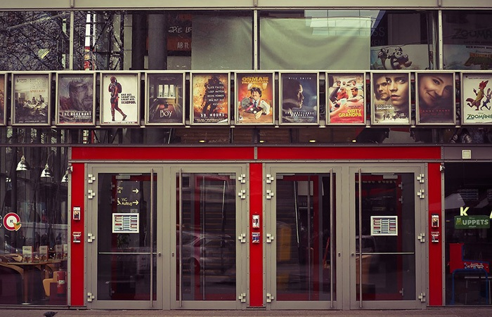 Photo of the entrance to a movie theater as an example of getting a job writing movie reviews
