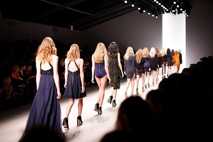 Photo of a fashion show runway as an example of getting paid to write about fashion