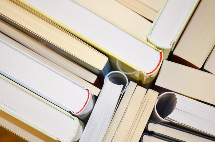 Photo of a stack of books as an example of getting paid to write fiction