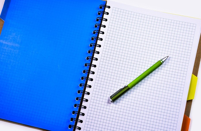 Photo of an open planner as an example of getting paid to wrote lesson plans