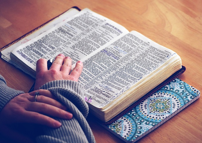 Photo of an open Bible on a desk as an example of Christian freelance writing jobs