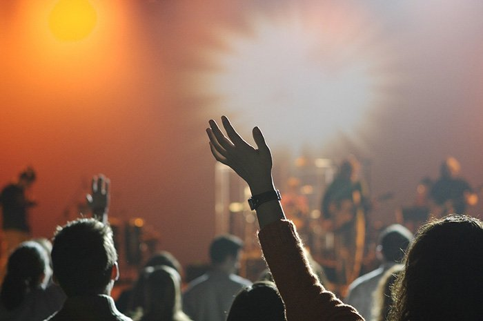 Photo of people attending a rock concert as an example of music reviews