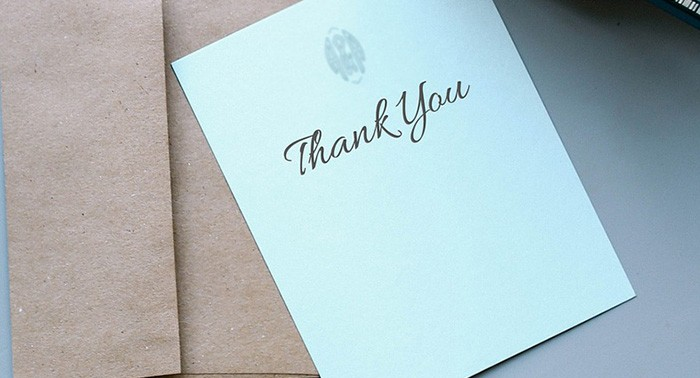 Photo of a Thank You note sitting on a table