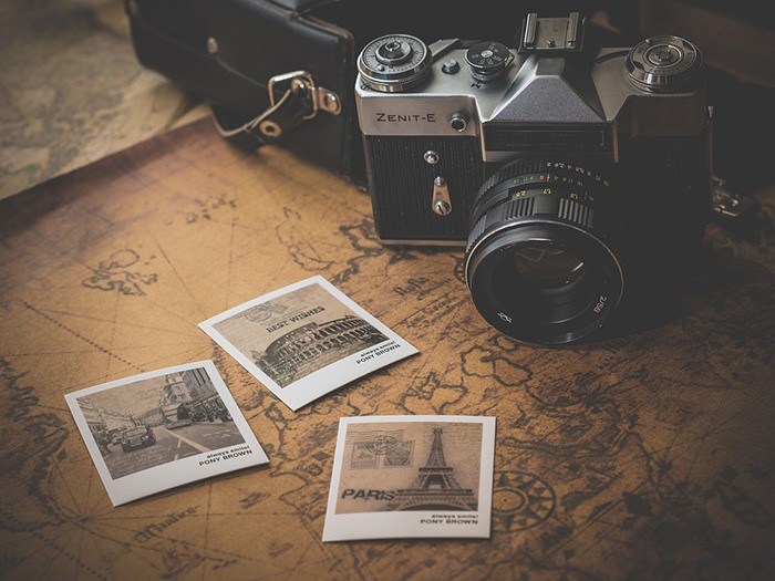 Photo of a camera sitting on a world map as an example of travel reviews