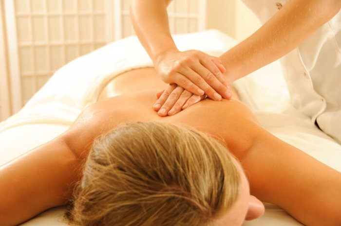Image of blonde lady receiving a massage from a professional massage therapist