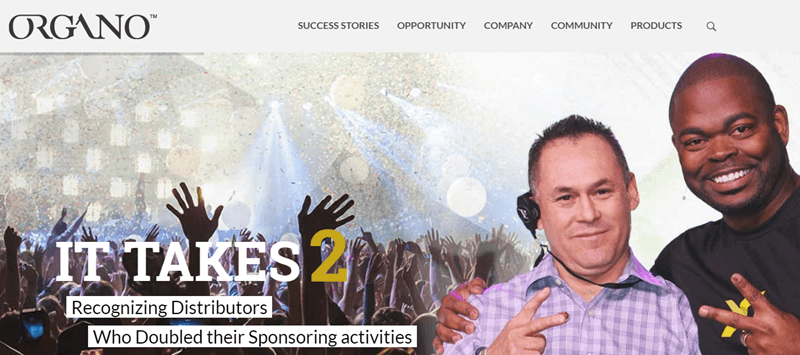 Organo Website Screenshot showing a crowd at a conference, along with two distributors.