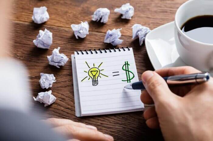 image of hand drawn light bulb and dollar sign representing brainstorming ways to make 50 dollars
