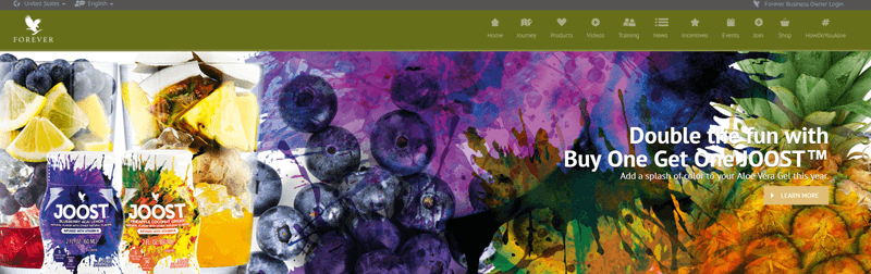 Forever Living website screenshot showing two Joost containers along with a pineapple, blueberries and some splashes of color.