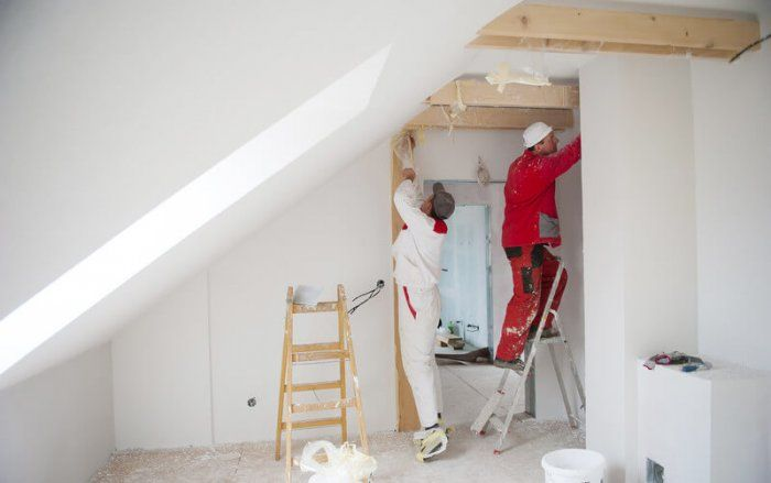 to professional painters painting an attic