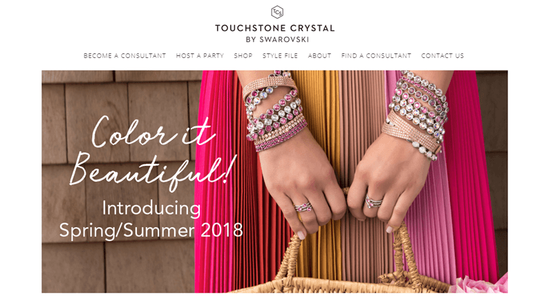 Touchstone Crystal website screenshot showing a woman with many different pink and white bracelets (and some rings).