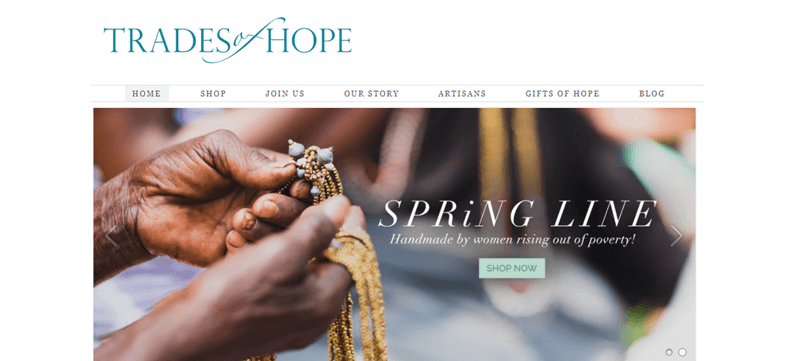 Trades of Hope website showcasing a pair of brown hands working on creating a necklace of some kind.