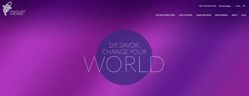 Traveling Vineyard website screenshot showing a purple background and the phrase 'Sip. Savor. Change Your World'.