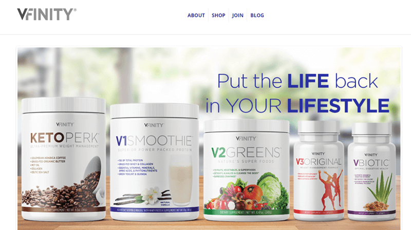 Vfinity website screenshot showing five products on a table in a well-lit room.