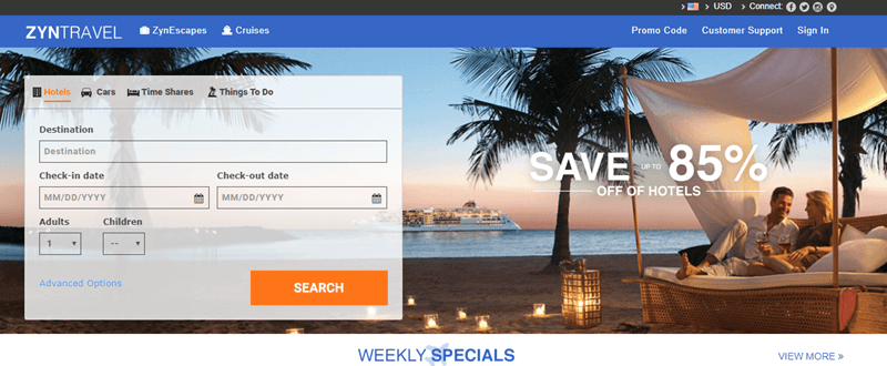 ZynTravel website screenshot showing a photograph of a couple on a sofa bed sitting on the beach in the early evening.
