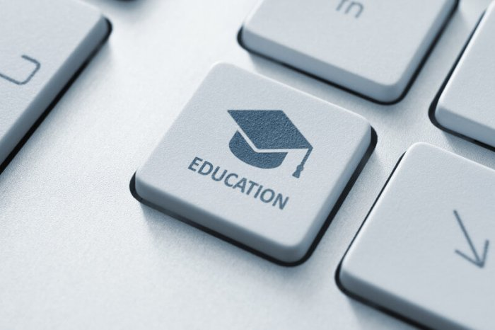 """graduation cap on a keyboard button with the word """"education"""" below the cap"""