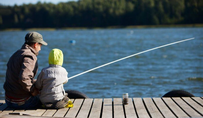 older man and young boy fishing off a dock representing best fishing affiliate programs