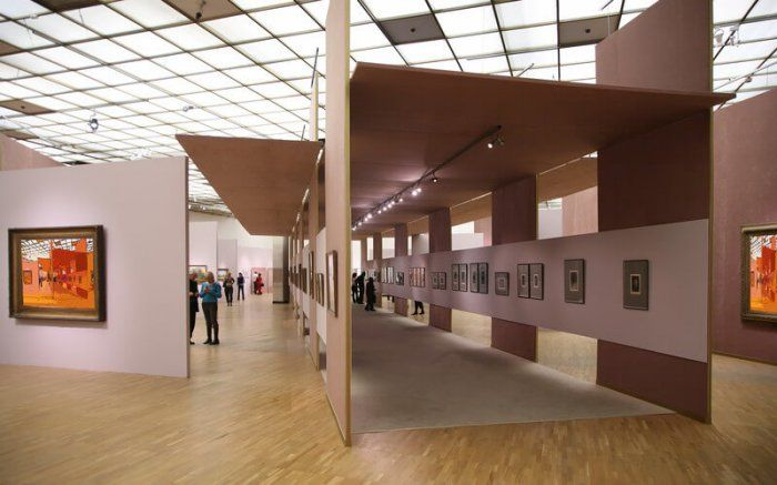 art gallery with paintings and long hallway representing the best gallery plugins wordpress