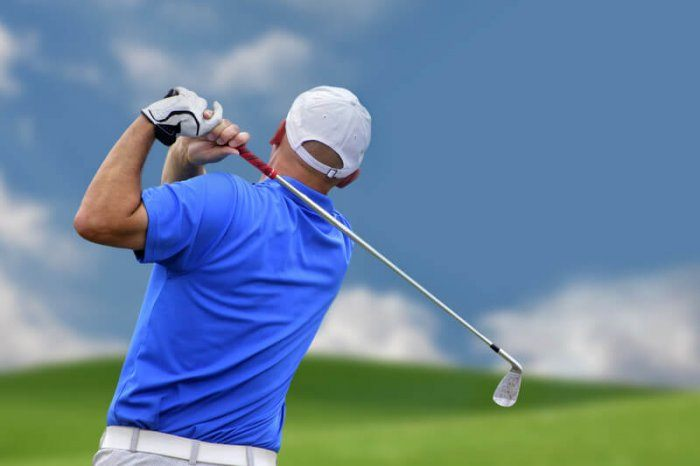 rear and back of golfer taking a swing representing the best golf affiliate programs
