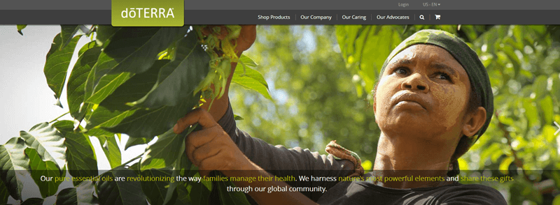 doTERRA website screenshot showing a young woman outside surrounded by leaves.