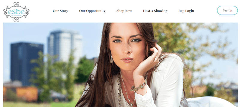 eSBe website screenshot featuring a brown haired woman outside wearing various pieces of jewelry.