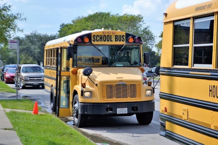 school bus parked in front of school