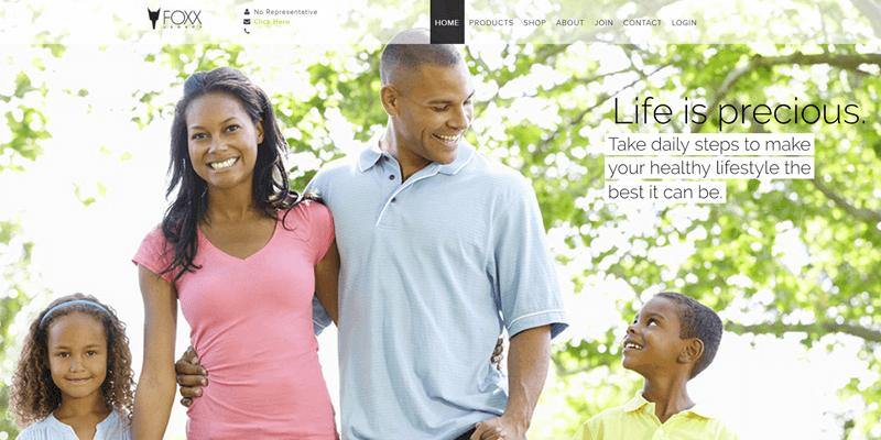 Foxx Legacy website screenshot showing an African American family outside enjoying the sunshine.