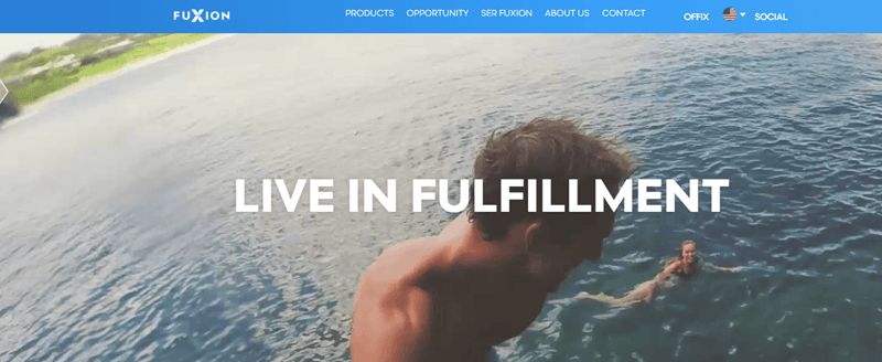 FuXion website screenshot showing a young woman swimming in the sea and a young man by the camera looking back at her.