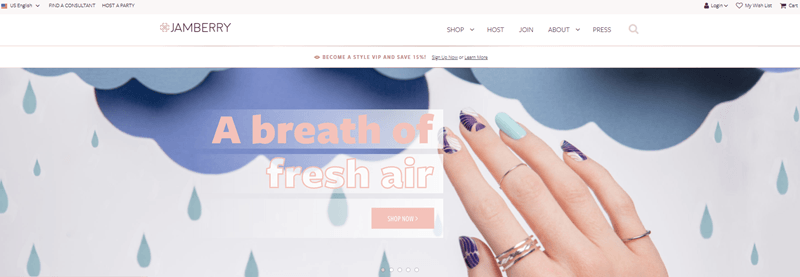 Jamberry website screenshot showing a woman's nails. Most of her nails are in a purple and white design, while one is light blue instead.