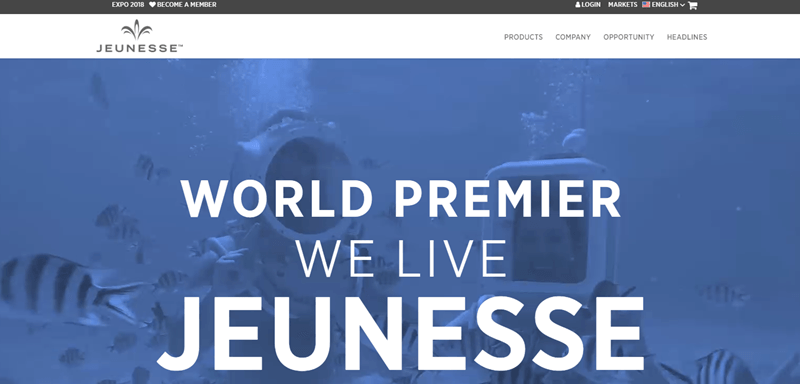 Jeunesse Global website screenshot showing a blue background with two divers deep underwater.