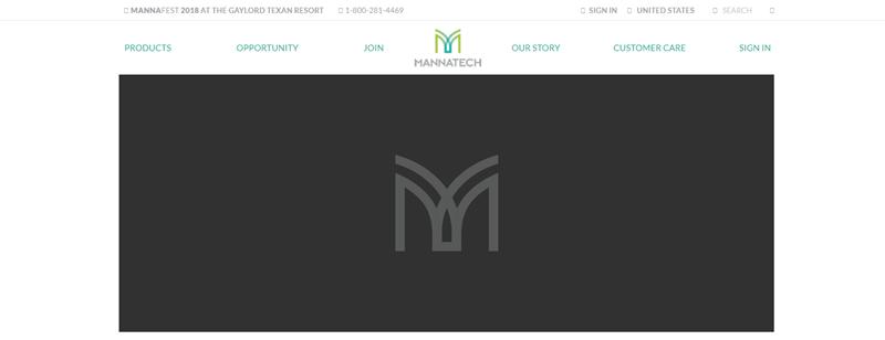 Mannatech website screenshot showing the light gray Mannatech logo against a dark gray background.