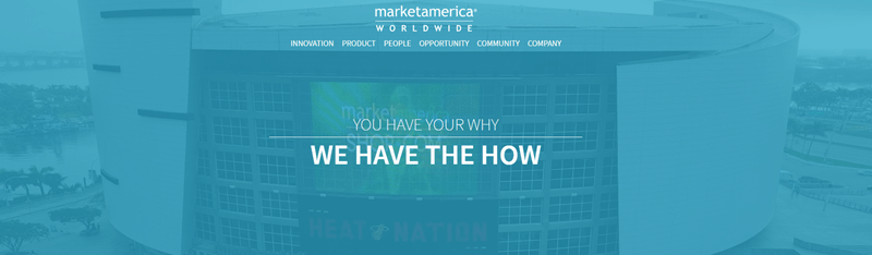 Market America website screenshot showing a background image of a large arena.