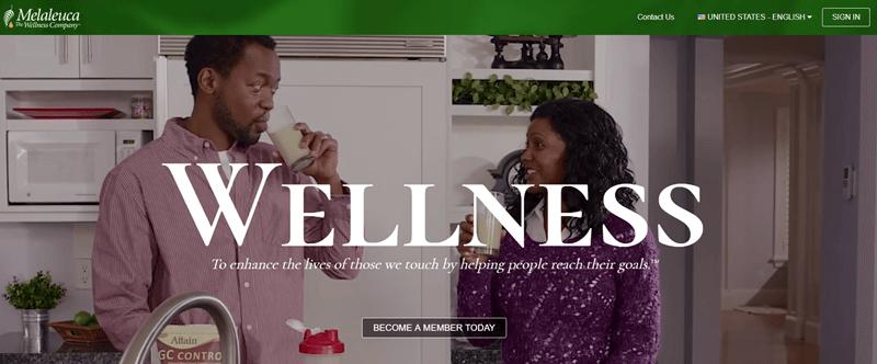 Melaleuca website screenshot showing a couple standing in a kitchen drinking milk.