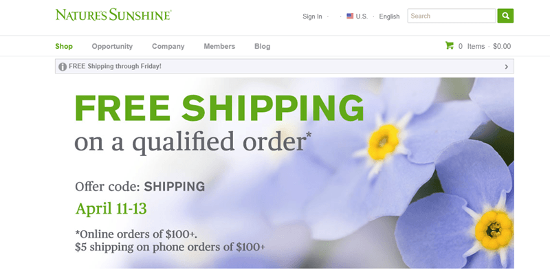Nature's Sunshine website screenshot showing a background image of blue flowers and details about shipping.
