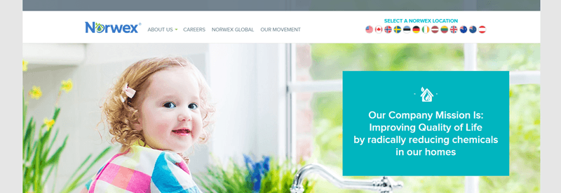 Norwex website screenshot showing a toddler sitting inside with various plants.