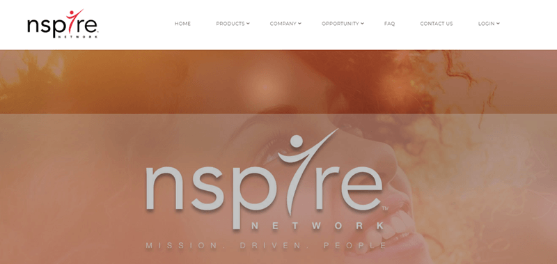Nspire Network website screenshot showing a woman with brown and curly hair smiling.